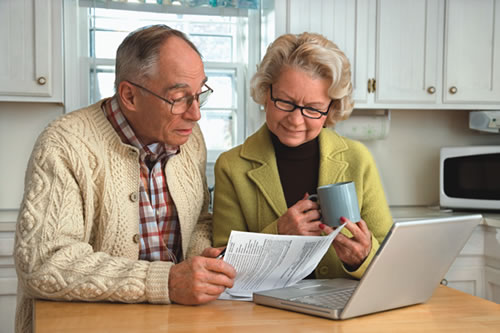 Older couple reviewing financial information